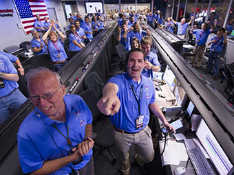 Celebrating Curiosity, NASA/JPL ground controllers react to learning the Curiosity rover had landed safely on Mars and begun to send back images to NASA's Jet Propulsion Laboratory on Sunday, Aug. 5, 2012. The rover will assess whether Mars ever had an environment able to support life forms. Credit: NASA/Bill Ingalls