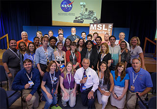 NASA Administrator Charles Bolden, front center, poses for a group photograph with participants in the Mars Science Laboratory (MSL) NASA Social held at the Jet Propulsion Laboratory on Sunday, Aug. 5, 2012 in Pasadena, Calif.  The MSL Rover named Curiosity was designed to assess whether Mars ever had an environment able to support small life forms called microbes. Curiosity is due to land on Mars at 10:31 p.m. PDT on Aug. 5, 2012 (1:31 a.m. EDT on Aug. 6, 2012). Photo Credit: (NASA/Bill Ingalls)NASA Administrator Charles Bolden, front center, poses for a group photograph with participants in the Mars Science Laboratory (MSL) NASA Social held at the Jet Propulsion Laboratory on Sunday, Aug. 5, 2012 in Pasadena, Calif.  The MSL Rover named Curiosity was designed to assess whether Mars ever had an environment able to support small life forms called microbes. Curiosity is due to land on Mars at 10:31 p.m. PDT on Aug. 5, 2012 (1:31 a.m. EDT on Aug. 6, 2012). Photo Credit: (NASA /Bill Ingalls)